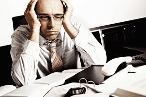 Man feeling tense on his desk