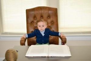 A kid on a office desk
